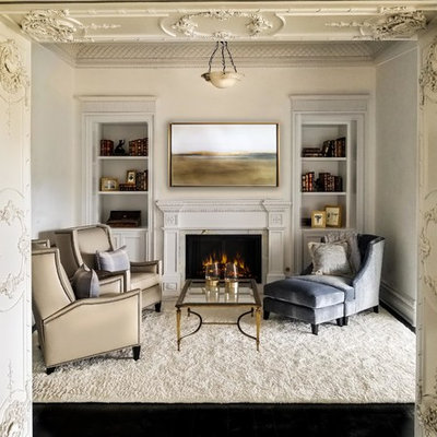 Example of a huge classic enclosed dark wood floor and black floor living room design in Los Angeles with white walls and a standard fireplace