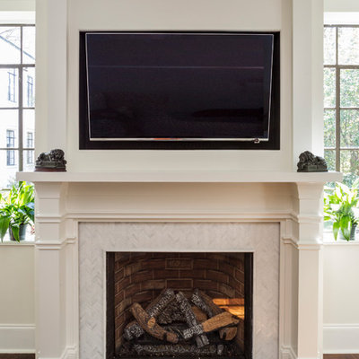 Mid-sized transitional formal and enclosed dark wood floor and brown floor living room photo in Charlotte with a standard fireplace, a tile fireplace, a wall-mounted tv and gray walls
