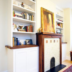 Mantel/bookcase - Reclaimed redwood mantel, custom made cabinetry, paper stone hearth and hand selected tiles.