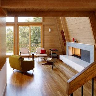 Foto de salón moderno con marco de chimenea de baldosas y/o azulejos