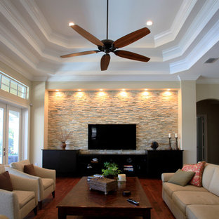 This is an example of a medium sized classic enclosed living room in Miami with beige walls, dark hardwood flooring, no fireplace, a wall mounted tv and red floors.