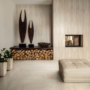 Example of a porcelain floor living room design in Other with beige walls, a two-sided fireplace and a tile fireplace