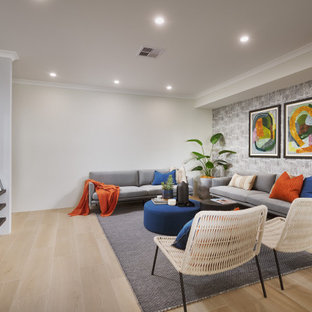 Design ideas for a contemporary living room in Perth with grey walls, medium hardwood floors, brown floor and wallpaper.