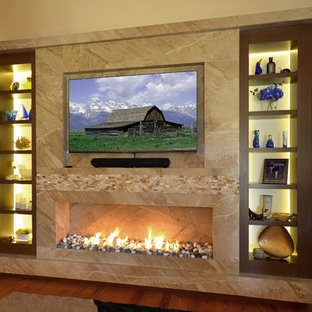 Large transitional open concept medium tone wood floor living room photo in Miami with a standard fireplace, a stone fireplace, a media wall and beige walls