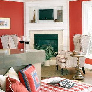 Living room - large beach style open concept medium tone wood floor living room idea in Boston with red walls, a standard fireplace and a stone fireplace