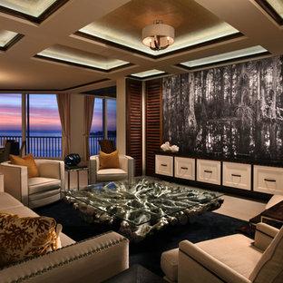Esempio di un ampio soggiorno design aperto con sala formale, nessun camino, TV nascosta, pareti beige e pavimento in pietra calcarea