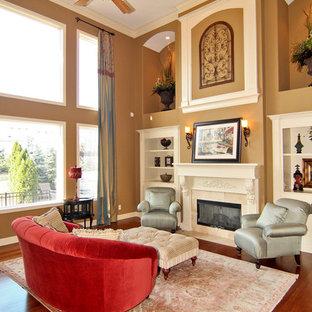 インディアナポリスの中サイズのトラディショナルスタイルのおしゃれなLDK (フォーマル、茶色い壁、無垢フローリング、標準型暖炉、石材の暖炉まわり、テレビなし) の写真