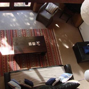 パースの小さいビーチスタイルのおしゃれなリビングロフト (フォーマル、茶色い壁、セラミックタイルの床、薪ストーブ、据え置き型テレビ) の写真