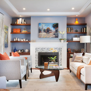 Example of a transitional living room library design in San Francisco with blue walls and a standard fireplace