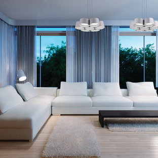 Esempio di un soggiorno minimalista di medie dimensioni e stile loft con sala della musica, pareti blu e parquet chiaro