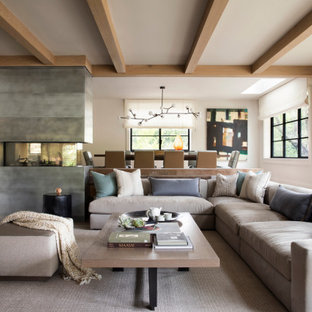 Inspiration for a transitional formal and open concept carpeted, gray floor, exposed beam and wallpaper living room remodel in San Francisco with a two-sided fireplace, a concrete fireplace and no tv