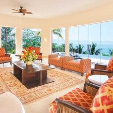 Tropical Living Room by arqflores / architect