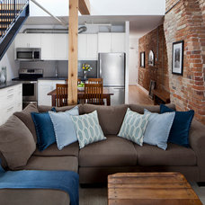 Industrial Living Room by Rad Design Inc