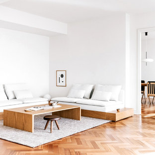 Inspiration for a mid-sized contemporary enclosed medium tone wood floor and beige floor living room remodel in San Francisco with white walls, no fireplace and no tv