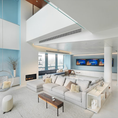 Inspiration for a huge contemporary open concept and formal living room remodel in San Francisco with blue walls, a ribbon fireplace and no tv