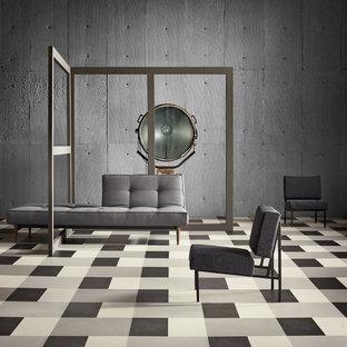 Ejemplo de salón abierto, moderno, grande, con paredes grises y suelo de linóleo