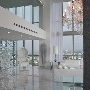Living room - huge contemporary formal and open concept porcelain floor living room idea in Miami with white walls and no tv