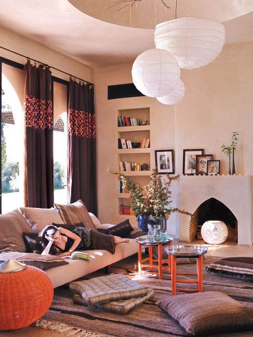 Tuscan living room photo in New York with beige walls and a standard  fireplace
