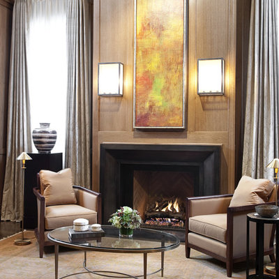 Example of a trendy living room design in Chicago with a metal fireplace and a standard fireplace