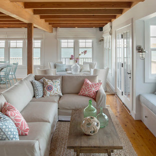 Inspiration for a mid-sized beach style open concept light wood floor living room remodel in Boston with white walls