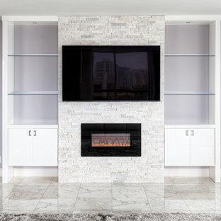 Ispirazione per un soggiorno moderno con sala formale, pareti grigie, pavimento in marmo, camino classico e TV a parete