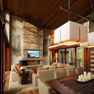 Mid-sized mountain style open concept medium tone wood floor living room photo in San Francisco with beige walls, a ribbon fireplace, a stone fireplace and a wall-mounted tv