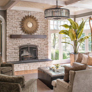 Example of a large transitional open concept medium tone wood floor and brown floor living room design in DC Metro with gray walls, a standard fireplace, a stone fireplace and no tv