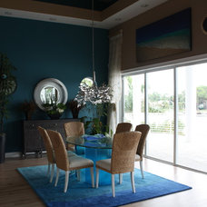 Tropical Living Room by CREATIVE DESIGN TEAM-Marya Flurnoy