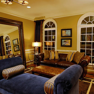 Example of a classic medium tone wood floor living room design in DC Metro with yellow walls