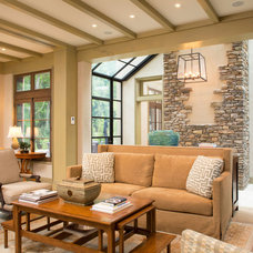 Mediterranean Family Room by Pyramid Builders