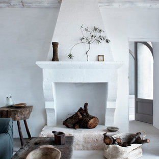 Inspiration for a mediterranean formal and enclosed living room remodel in London with white walls, a standard fireplace and no tv