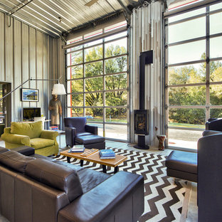 Example of a mid-sized urban open concept laminate floor and gray floor living room design in San Francisco with gray walls and a ribbon fireplace