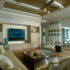 Tropical Living Room by Heffel Balagno Design Consultants