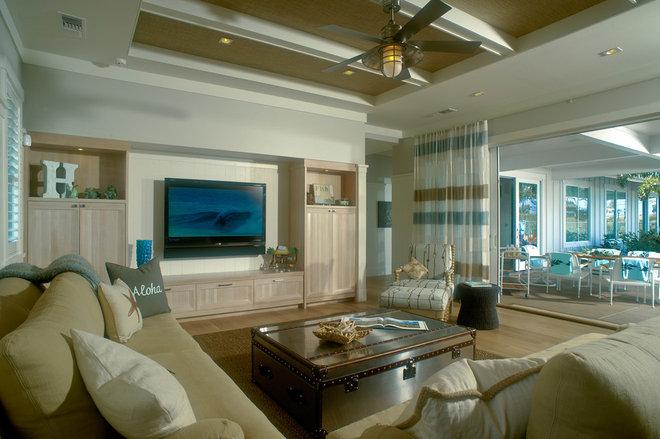 Tropical Living Room by Heffel Balagno Design Consultants