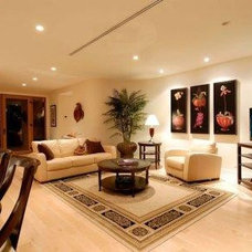 Tropical Living Room by Tervola Designs