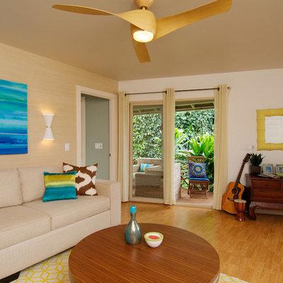 Living room - tropical medium tone wood floor living room idea in Los Angeles with beige walls