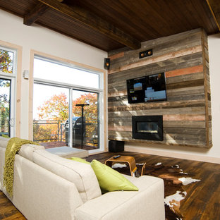 Living room - contemporary living room idea in Montreal with a ribbon fireplace and a wall-mounted tv