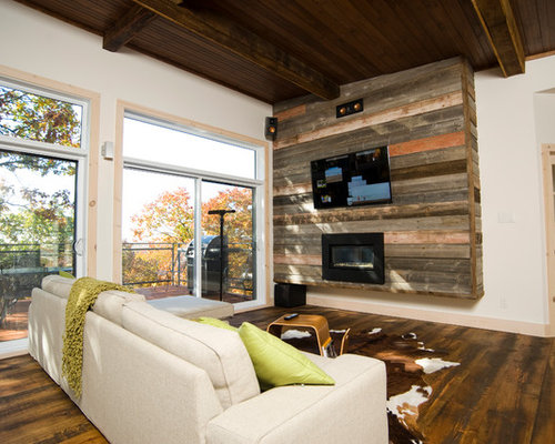Contemporary Living Room Idea In Montreal With A Ribbon Fireplace And Wall Mounted Tv