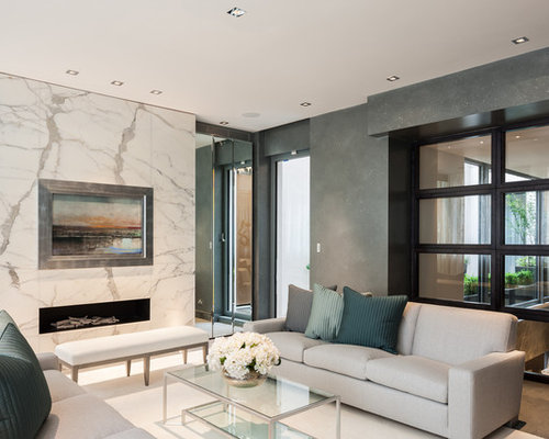 Charming Inspiration For A Contemporary Living Room In London With Grey Walls And A  Ribbon Fireplace.