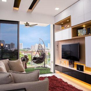 Diseño de salón actual, pequeño, con pared multimedia