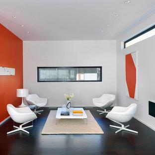 Ejemplo de salón cerrado, contemporáneo, sin chimenea y televisor, con parades naranjas