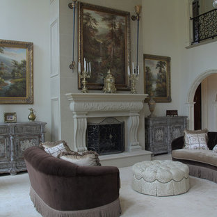 This is an example of a large victorian formal enclosed living room in Other with white walls, limestone floors, a standard fireplace, a stone fireplace surround, no tv and beige floor.