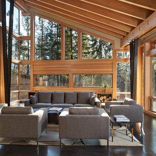 Идея дизайна: большая открытая, парадная гостиная комната в современном стиле с бетонным полом, стандартным камином и фасадом камина из камня