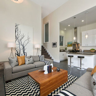 Inspiration for a contemporary formal and open concept concrete floor living room remodel in San Francisco with white walls
