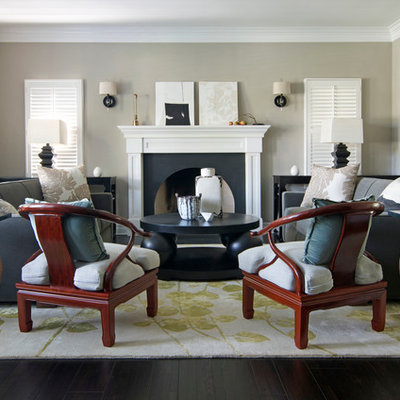 Inspiration for a large zen formal and enclosed dark wood floor living room remodel in Los Angeles with beige walls, a standard fireplace and no tv