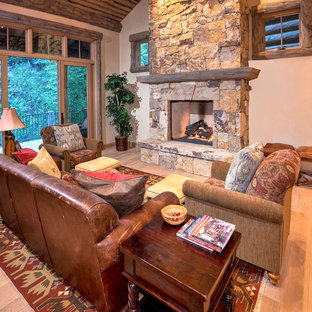 Photo of a rustic living room in Denver with beige walls, light hardwood flooring, a standard fireplace and no tv.