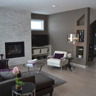 Design ideas for a classic living room in Calgary with grey walls, a standard fireplace and a freestanding tv.