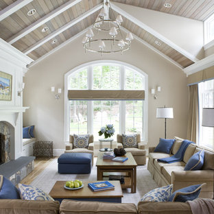 Inspiration for a large traditional enclosed living room in DC Metro with beige walls, a standard fireplace and a stone fireplace surround.