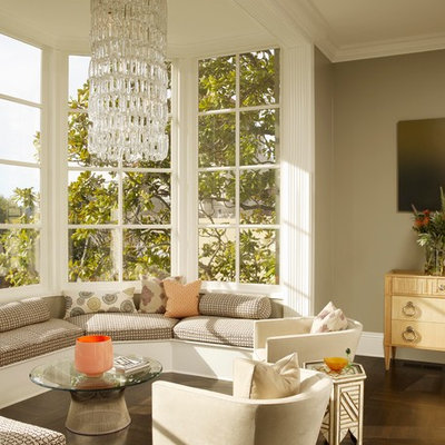 Eclectic dark wood floor and brown floor living room photo in San Francisco with green walls
