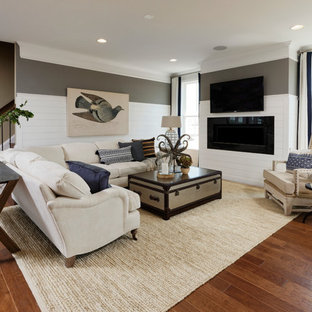 Photo of an expansive beach style formal open plan living room in DC Metro with multi-coloured walls, vinyl flooring, a wall mounted tv, brown floors, a ribbon fireplace and a wooden fireplace surround.